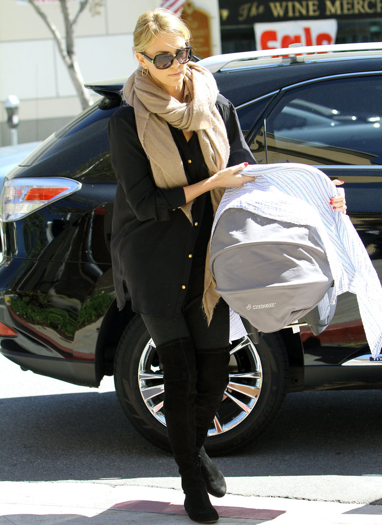 Charlize Theron carried her son Jackson to lunch.