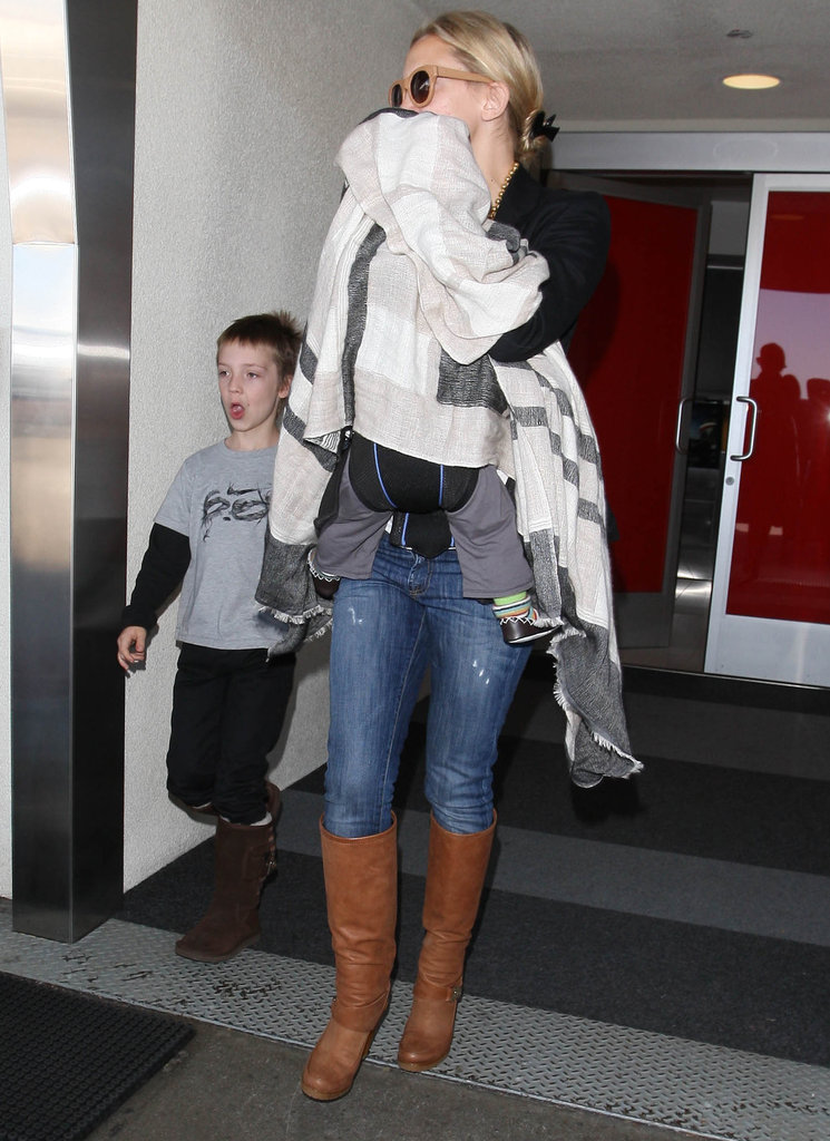 Kate Hudson with sons Ryder Robinson and Bingham Bellamy at the airport.