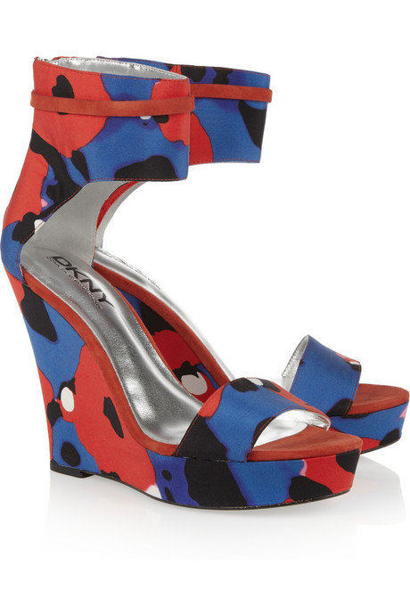 The abstract print feels just a tad girlie, but the shape is all sophisticate.  DKNY Printed Canvas Wedge Sandal ($275)