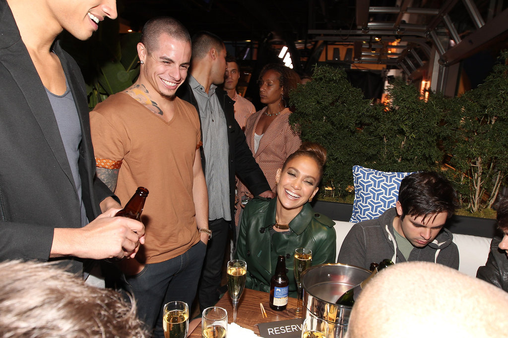 Jennifer Lopez and Casper Smart laughed during a party.