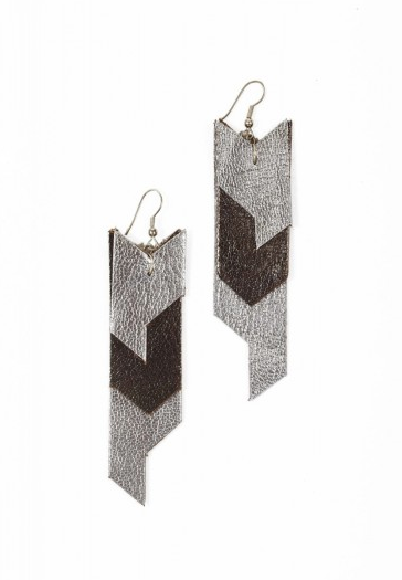 We love the juxtaposition of silver against gunmetal leather in this simple chevron-patterned earring set. Each unique pair is handcrafted by marginalized Muslim women in Northern India. To help break the cycle, proceeds from this jewelry go back to the women and their children in regard to health care and literacy. Zia: Chevron Leather Earrings ($22)