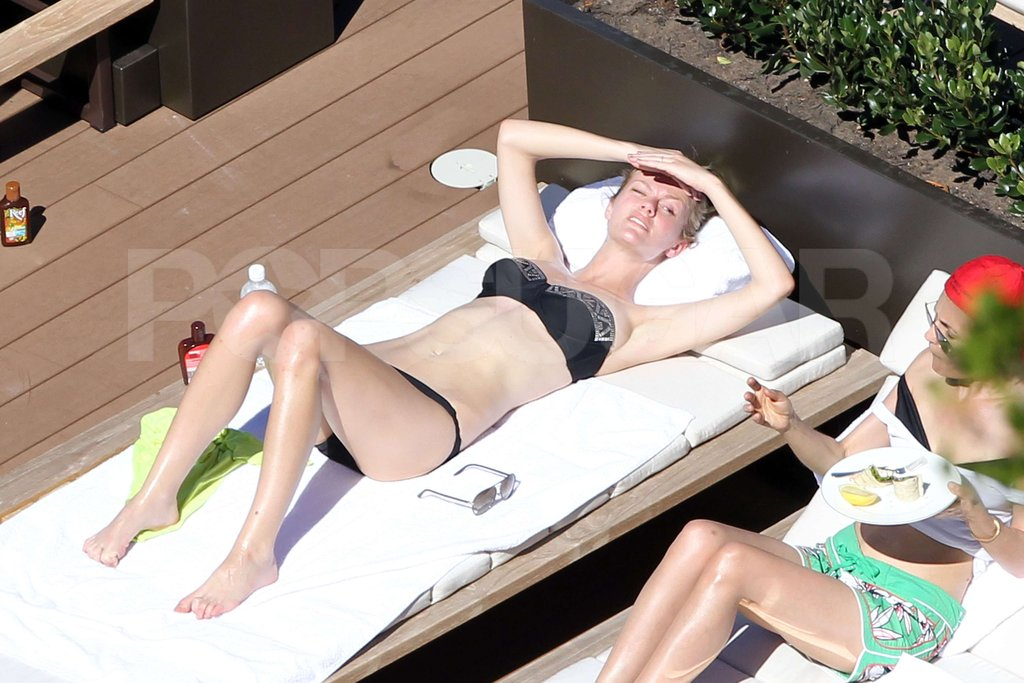 Brooklyn Decker got some sun while laying out in her bikini with a friend in Australia.