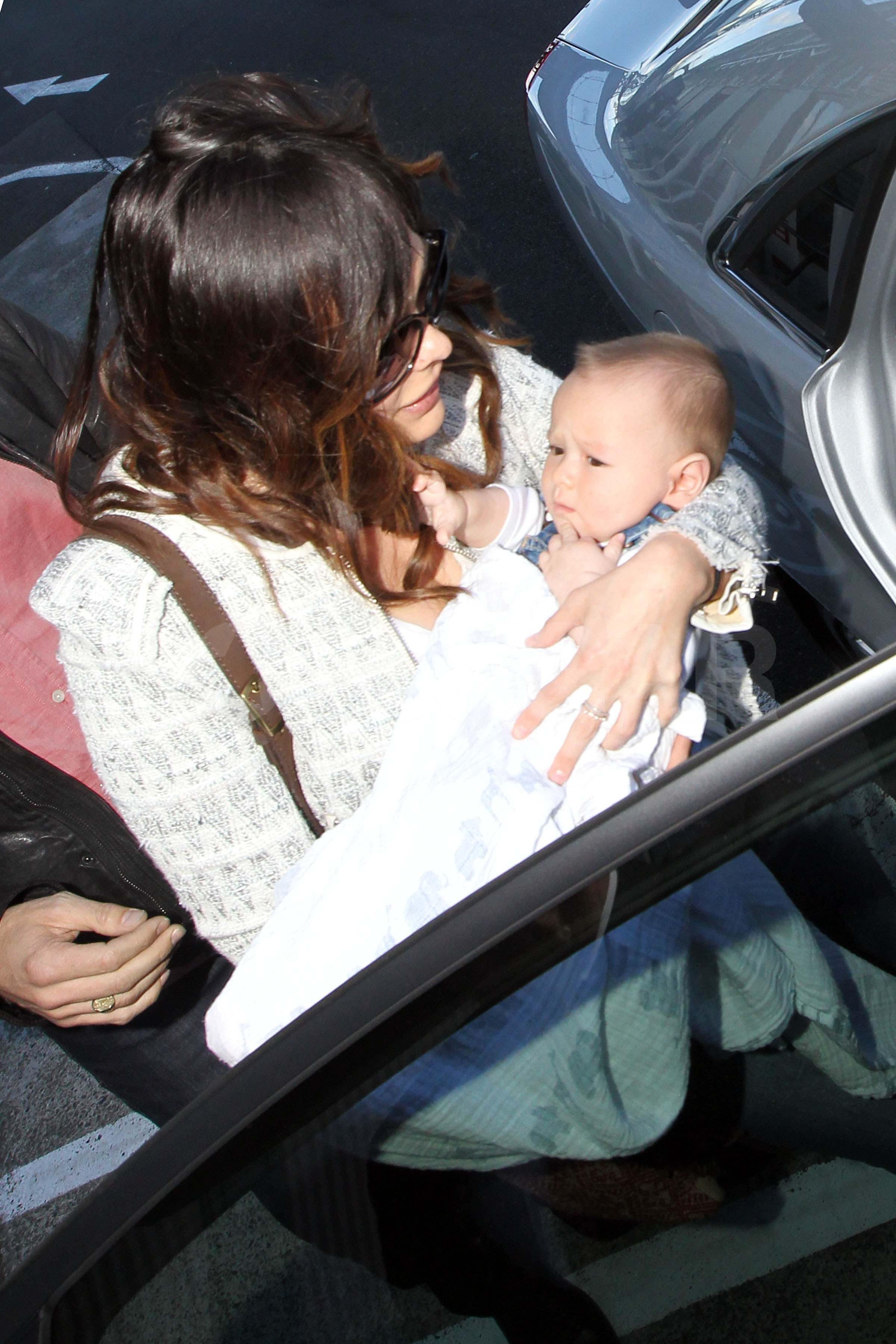 Lindsay Price carried baby Hudson in Australia.