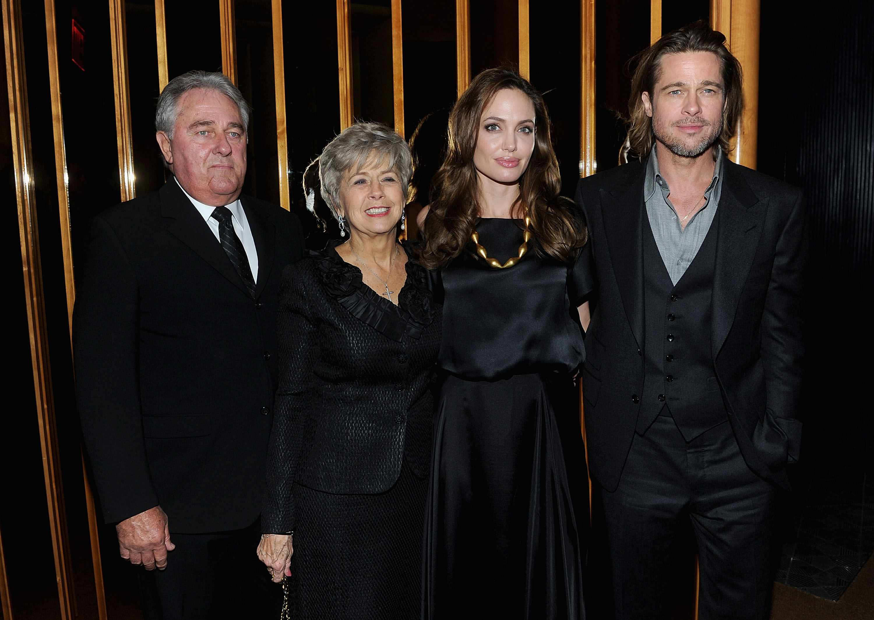 It was a family affair for Angelina Jolie and Brad Pitt when his parents, Jane and Bill, joined them at her NYC premiere of In the Land of Blood and Honey.