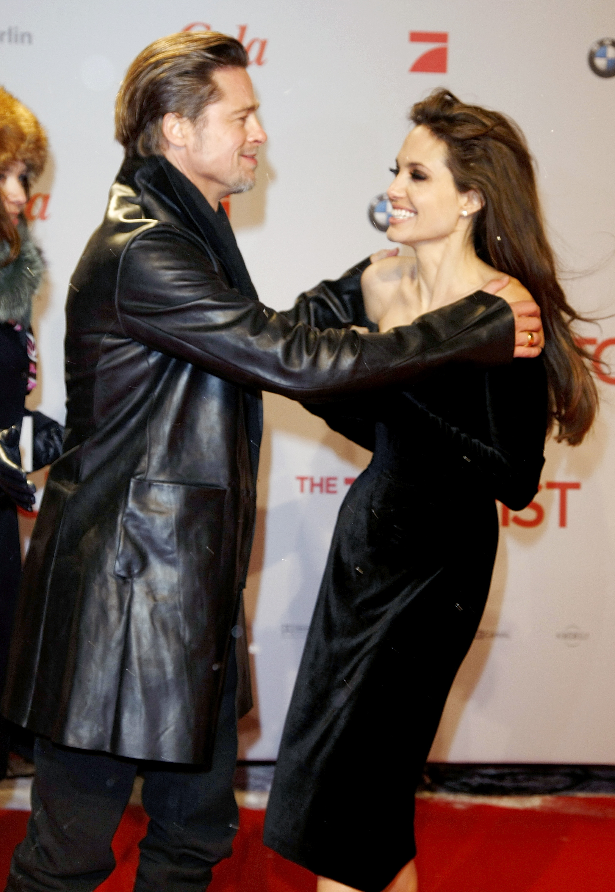 Brad Pitt warmed Angelina Jolie up at her December 2010 German premiere of The Tourist.