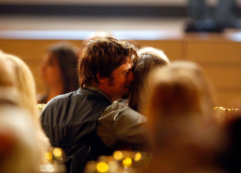 Brad whispered into Angelina's ear at the Critics' Choice Awards in January 2008.