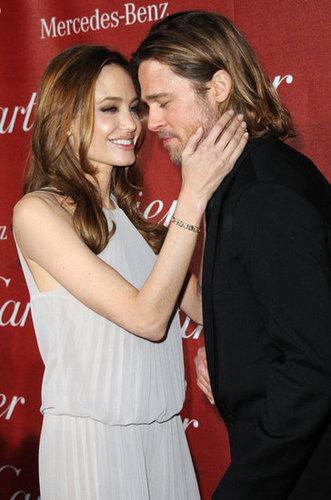 Angelina Jolie stroked Brad Pitt's cheek at the January 2010 Palm Springs Film Festival Awards.
