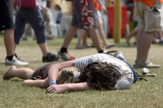 A pair relaxed together during the Isle of Wight Festival in the Isle of Wight, England.
