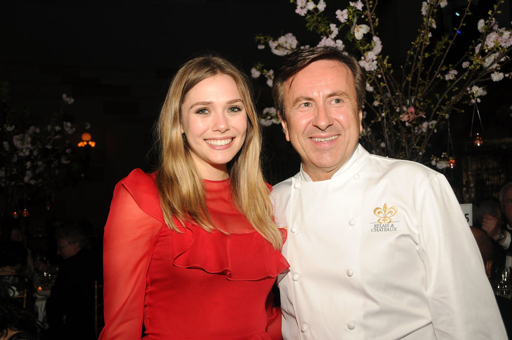 Elizabeth Olsen posed alongside chef Daniel Bouloud at the Grand Chefs Dinner in NYC.