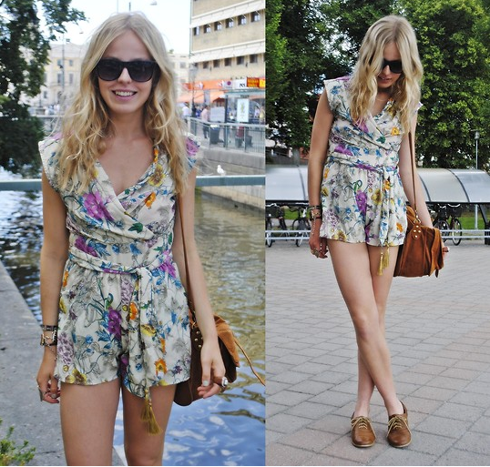 A floral romper like this is a girly staple. Just wear it the way you might a pretty blouse and shorts, and style with a pair of cool flats and a messenger bag for running errands. Photo courtesy of Lookbook.nu