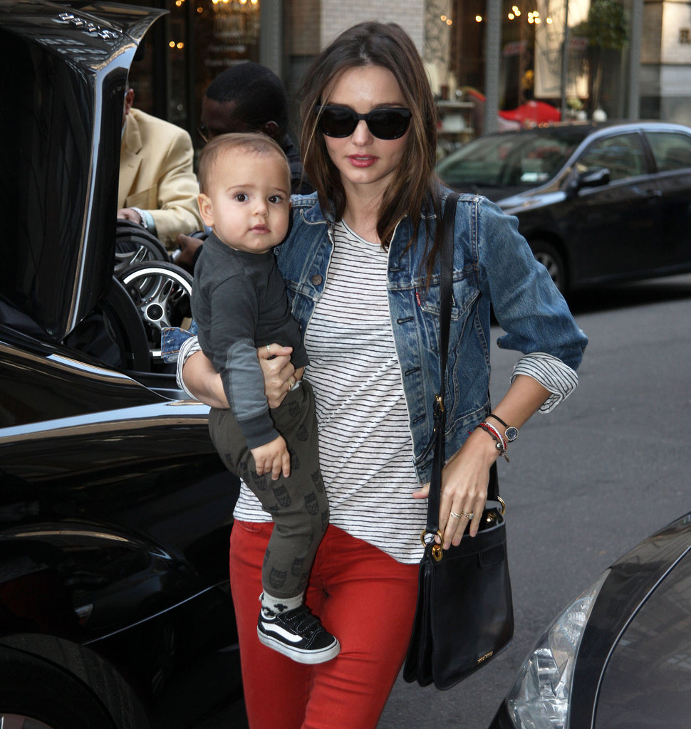 Flynn Bloom stuck close to Miranda Kerr during one of their many walks around NYC in March 2012.