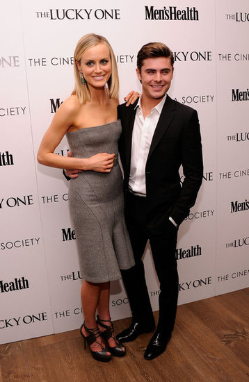Zac Efron held onto Taylor Schilling as they posed at the Cinema Society and Men's Health screening of The Lucky One in NYC.