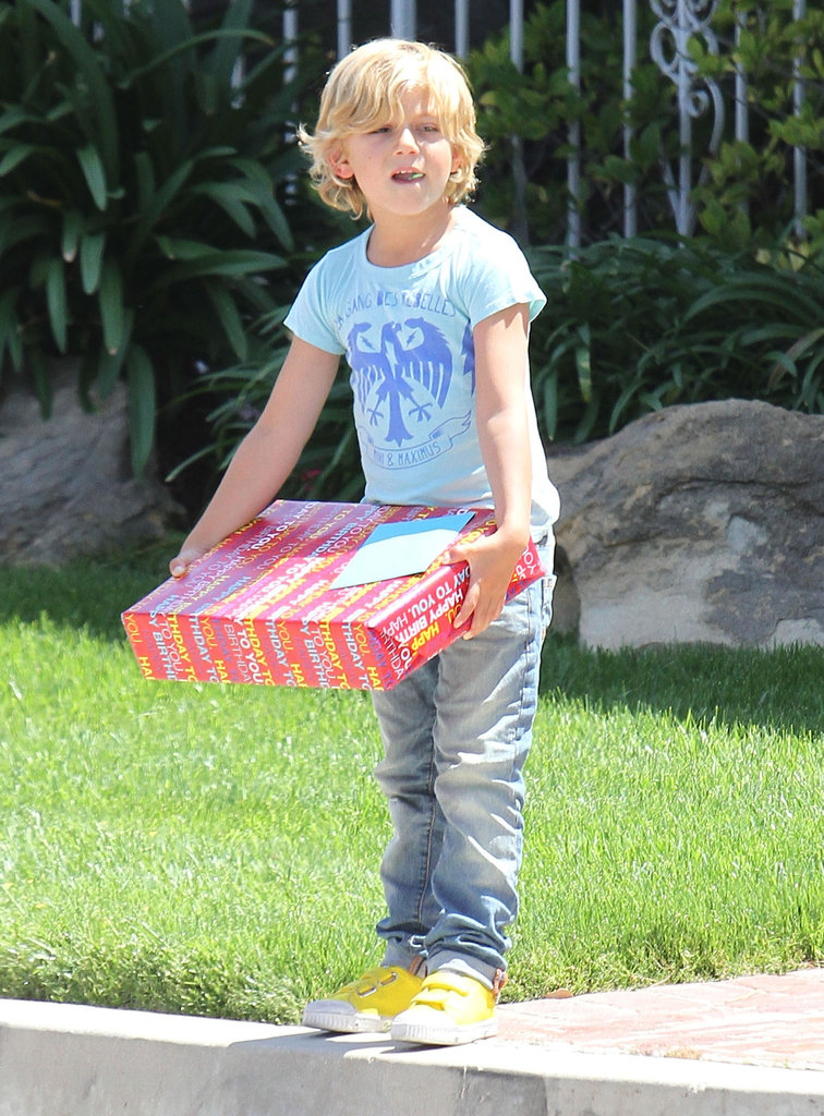 Kingston Rossdale brought a gift to a birthday party in LA.