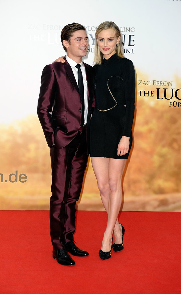 Zac Efron and Taylor Schilling walked the red carpet together at The Lucky One premiere.
