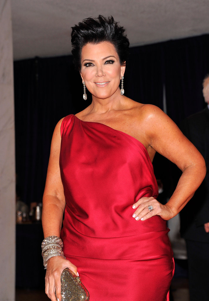 Kris Jenner posed in a red one-shoulder dress.