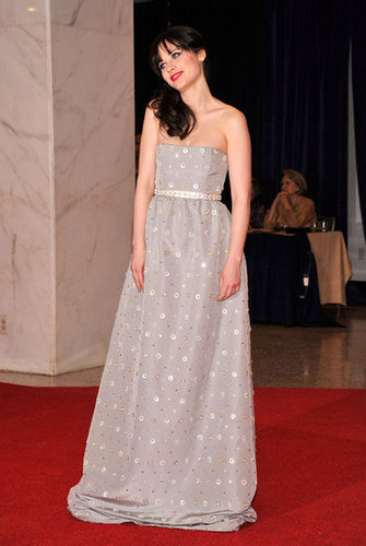 Zooey Deschanel wore a strapless silver gown.