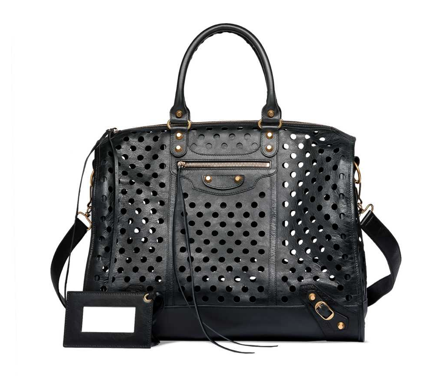 """""""My newest mission is finding a way to get this bag. I've always had a thing for the street-styled cool of a Balenciaga bag, but this one's perforated detailing makes it even more covetable. I think of this as the kind of purchase that could forever change my wardrobe — it would even make jeans and a white tank look chic."""" — Hannah Weil, assistant editor  Balenciaga Kraft Polka Dot Bag ($1,795)"""