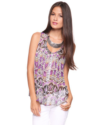 Airy, sheer chiffon in a colorful print looks clean and crisp with white bottoms.  Forever 21 Ikat Chiffon Top ($20)