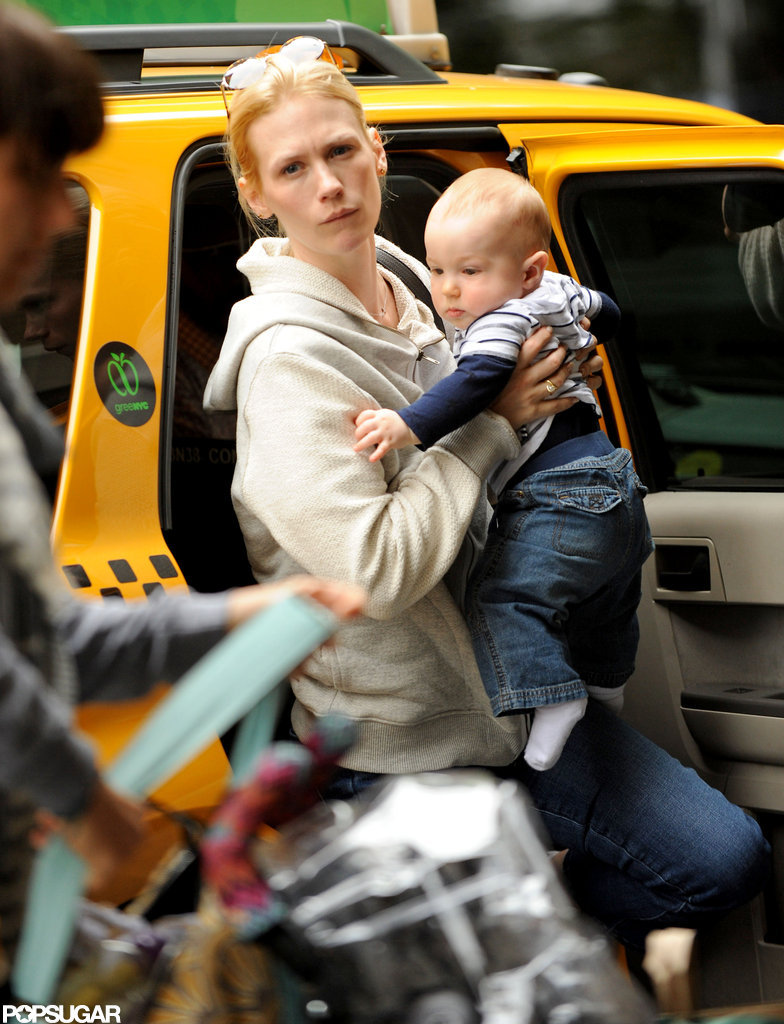 January Jones wore sunglasses on her head and picked up Xander in NYC.