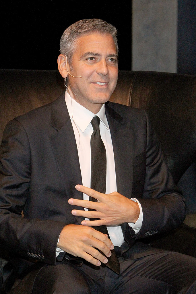 George Clooney wore a black suit with a black tie in Houston.
