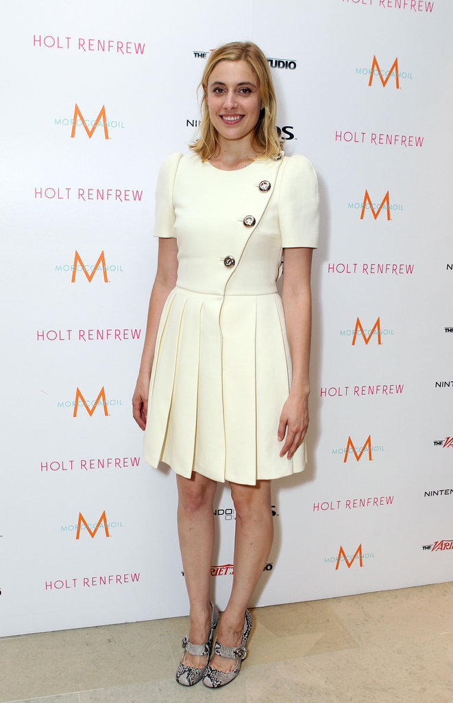 In September 2011, Greta showed off a retro cream-colored pleated dress with snakeskin pumps.  6855811