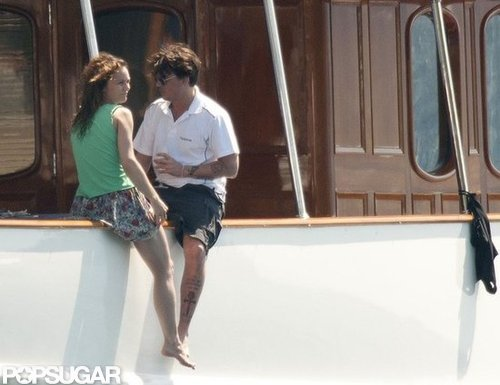 Johnny Depp and Vanessa Paradis hung out on the side of their yacht during an August 2011 trip to France.