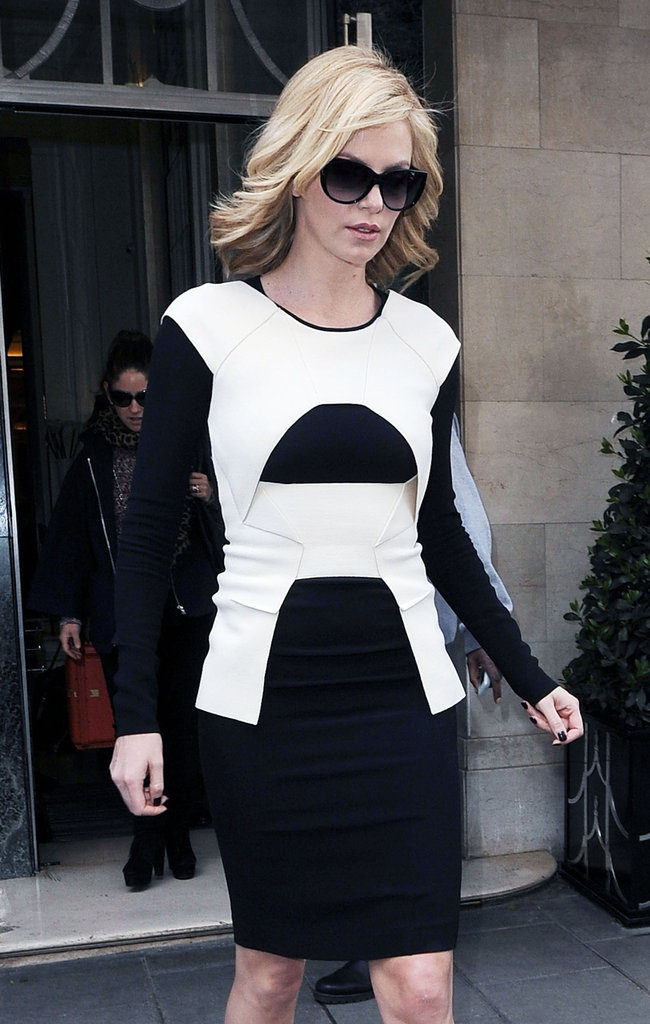 Charlize Theron wore a black and white dress.
