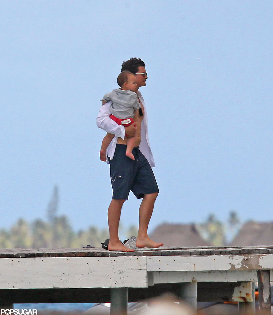 Orlando Bloom held onto baby Flynn on a dock in Bora Bora.