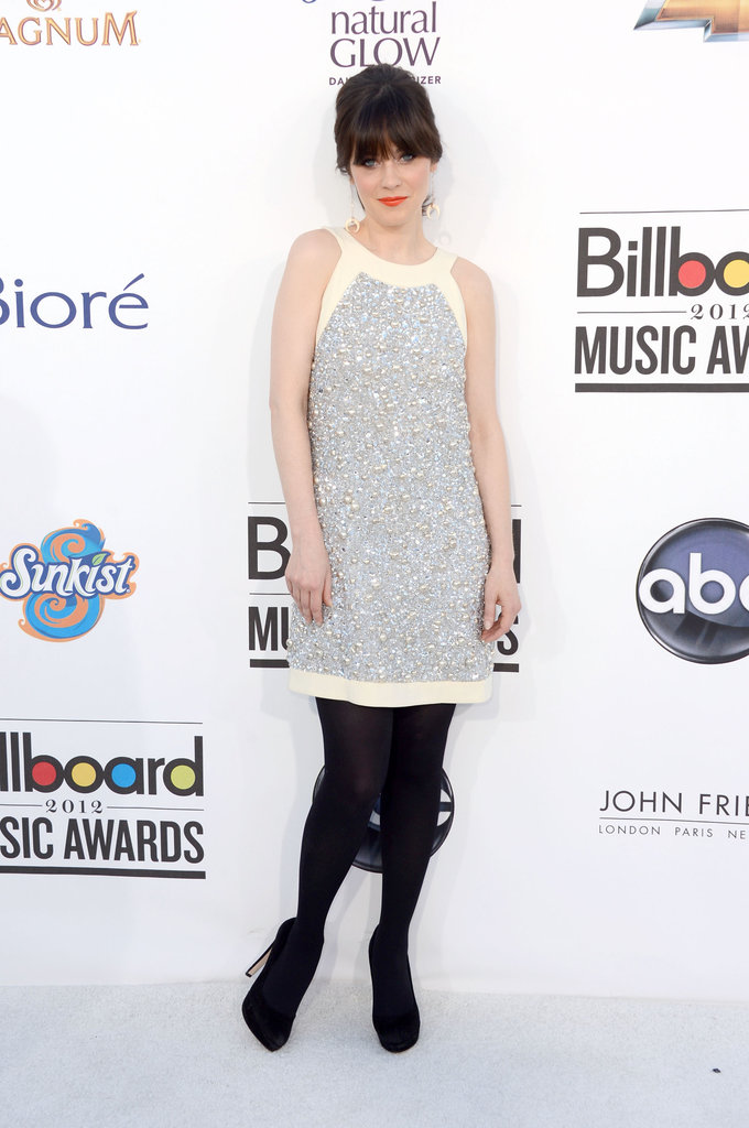 Zooey Deschanel donned a retro sequin-embellished halter-style frock with black tights and black pumps.