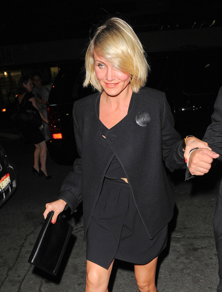 Cameron Diaz carried a cute black clutch with her to the occasion.