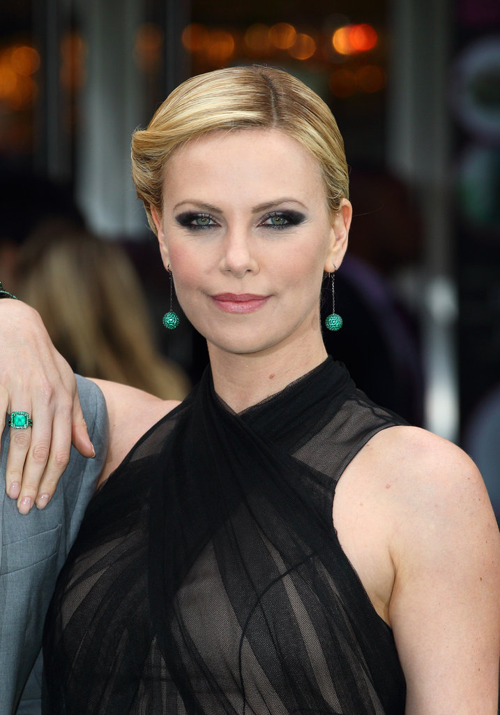 Charlize perfected the look with just the right jewels, makeup, and up do.