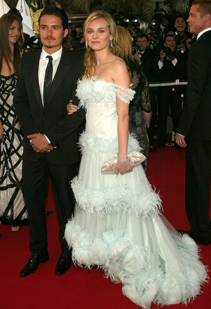 At the 2004 Troy world premiere, she walked arm in arm with Orlando Bloom and wore a feather-infused Chanel Haute Couture gown.