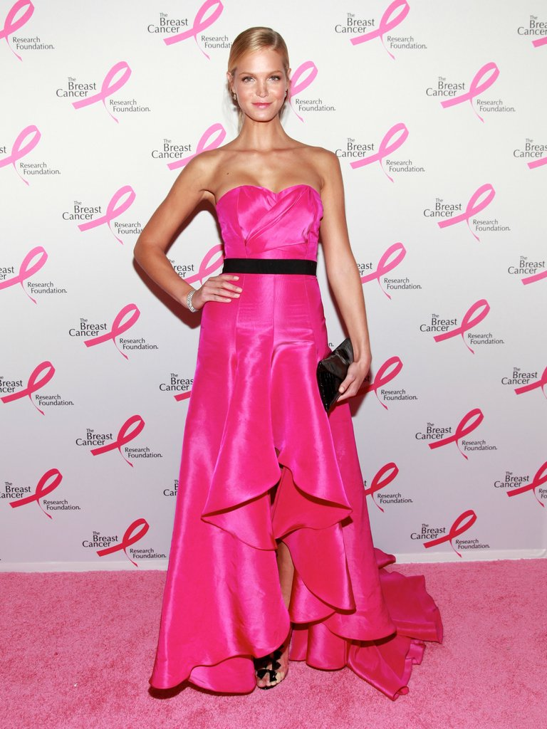 Erin Heatherton generated heat in a hot pink Michael Kors gown with a high-low hem and black waistband. Her sleek, slicked-back hairstyle and simple clutch keep all eyes on the gown's amazing shade of pink.  6898629