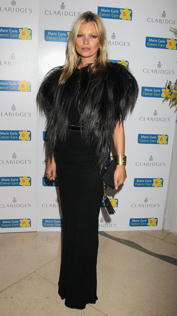Kate Moss looked smoking in an all-black evening look, including a fitted black maxi dress and a black fur jacket, at a charity event in London.