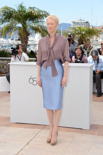 For Wes Anderson's Moonrise Kingdom photocall, Tilda Swinton played the sophisticated card in a two-toned outfit. Her semisheer taupe tie-front blouse was the perfect complement to the icy pastel blue pencil skirt and nude pumps she chose for the occasion.