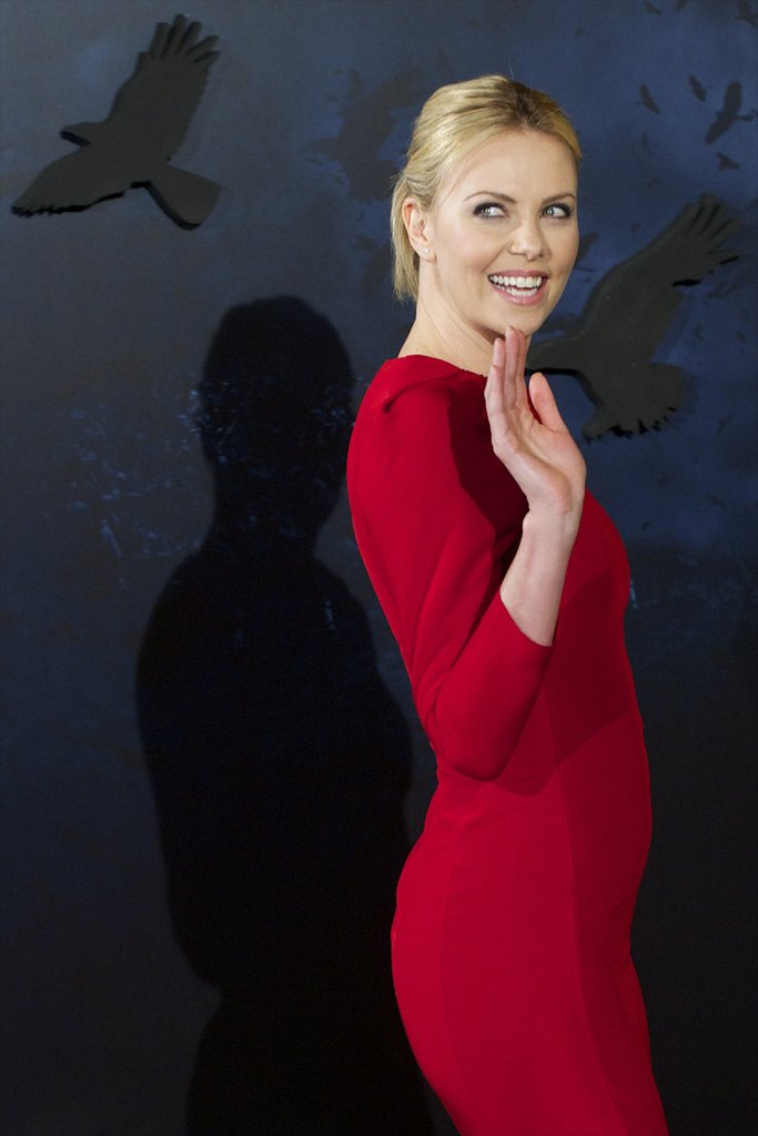Charlize Theron left the Snow White and the Huntsman photocall in Madrid with a wave.