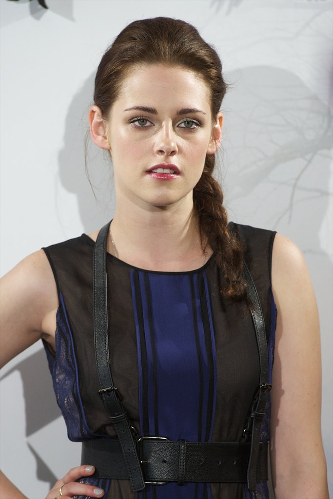 Kristen Stewart gave a sexy smile at the Snow White and the Huntsman photocall in Madrid.
