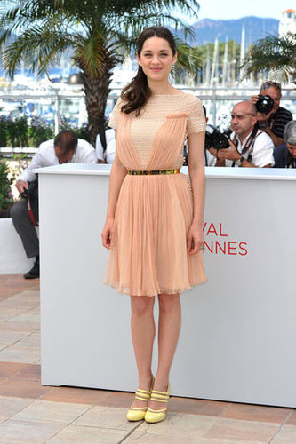 Marion Cotillard posed during the De Rouille et d'Os photocall in a peachy Dior frock, complete with sunny Versus slingback heels.