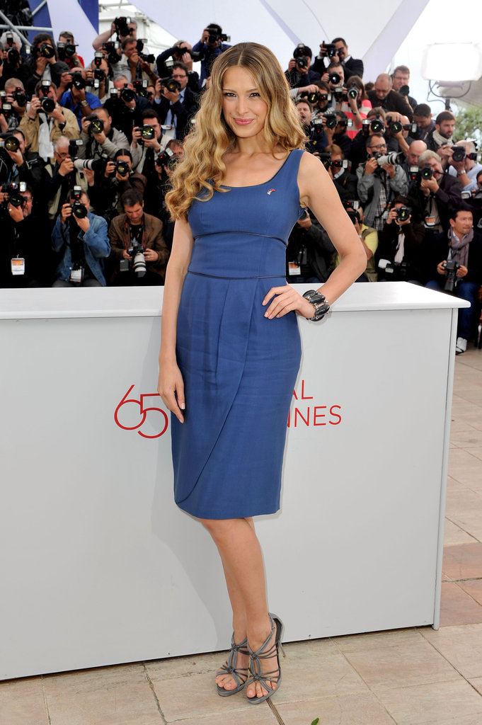 Petra Nemcova wore a Summery blue sheath and grey strappy sandals at the photocall for Haiti: Carnival.