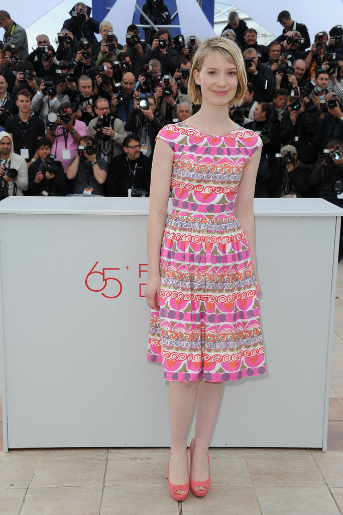 Mia Wasikowska chose a colorful pink-injected frock for the Lawless photocall.
