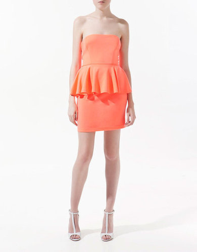 Ankle-strap sandals will pair perfectly with this subtly sexy option.  Zara Dress With Frills ($50)