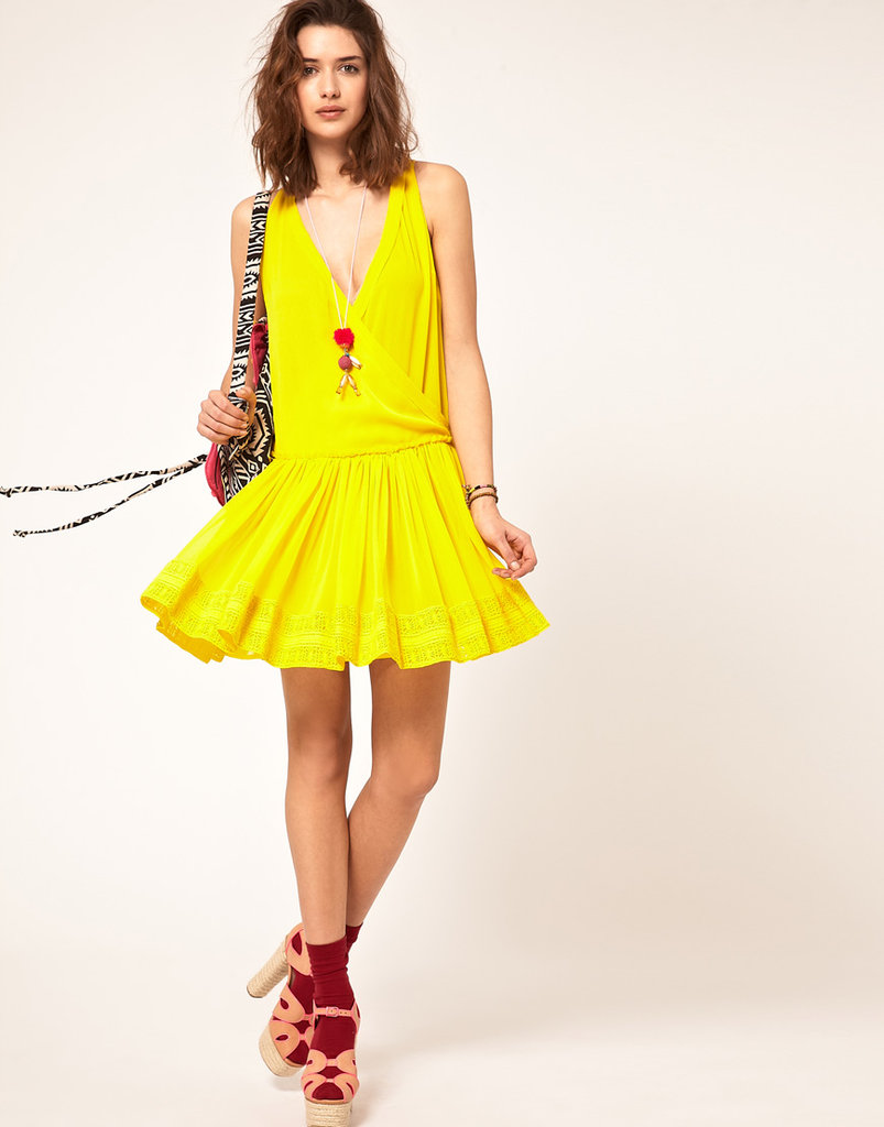 We can't get enough of this breezy crochet-trim dress; the color is brilliant, and it looks great with chunky wedges.  ASOS Crochet Dress with Dropped Waist ($87)