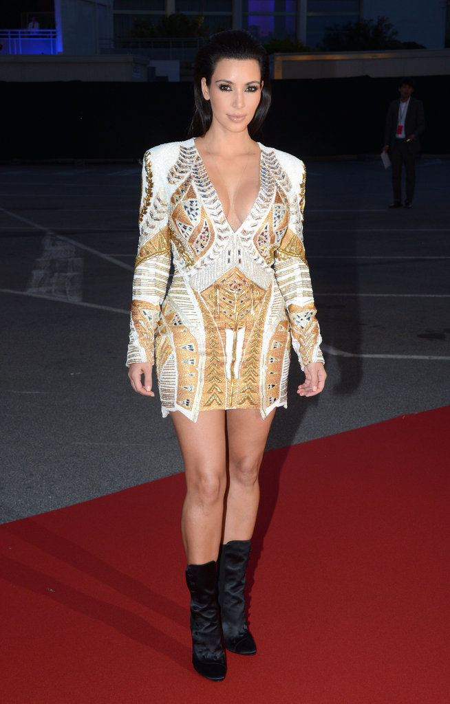 Kim Kardashian showed off her stems in Balmain's embellished minidress and ankle boots.