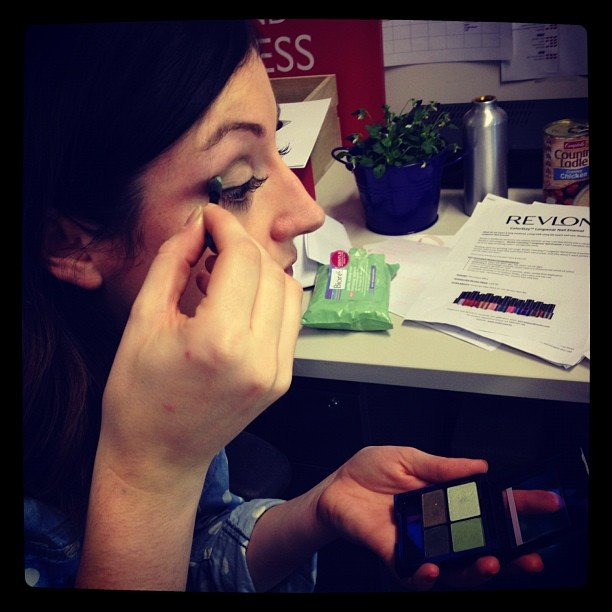 Sarah giving the new Revlon 16 hour eyeshadow quads a spin at her desk.