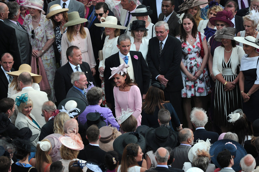 Kate Middleton stood out in the crowd wear a gorgeous pink coatdress.