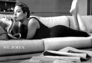 Angelina-Jolie-lounged-couch-while-reading-paper-one