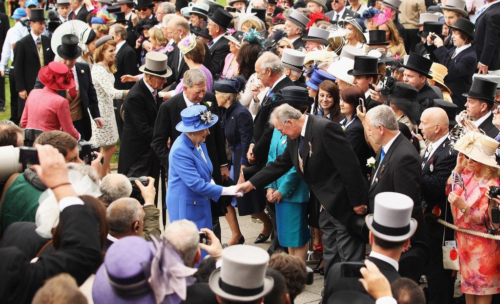 Queen Elizabeth greeted racegoers.