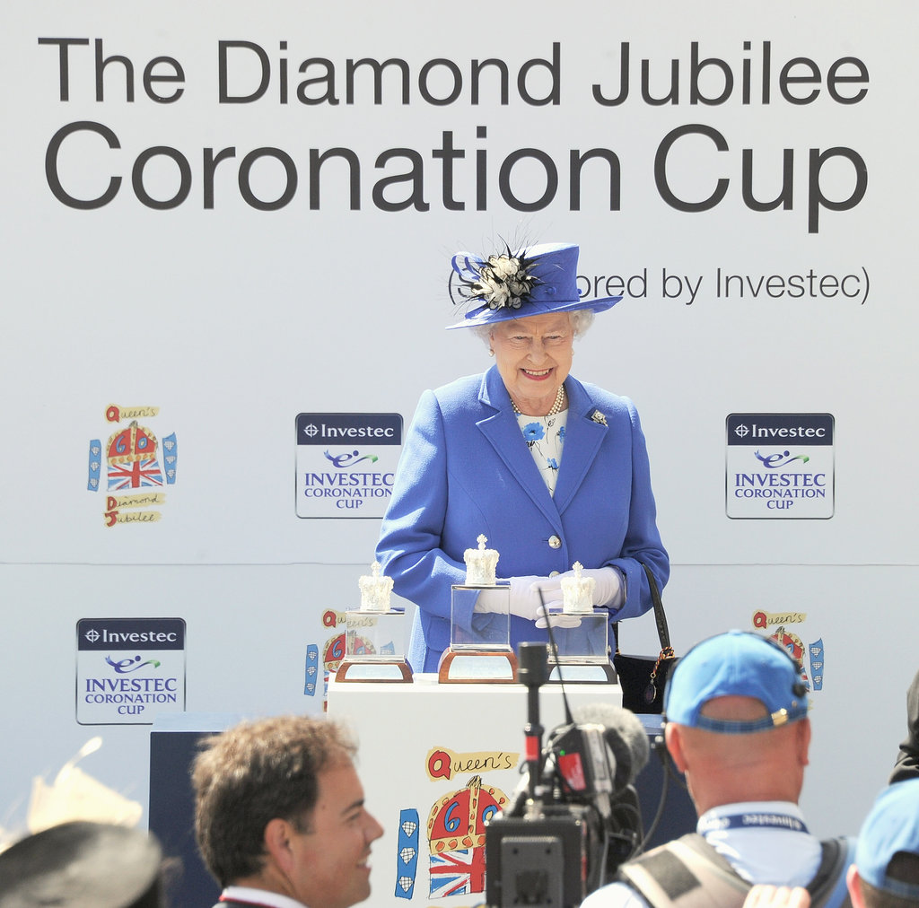 The queen smiles as she presented the Diamond Jubilee Coronation Cup.