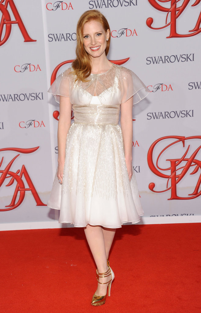 Jessica Chastain looked prim and pretty in a cream-colored Prabal Gurung tea dress with gold heels.