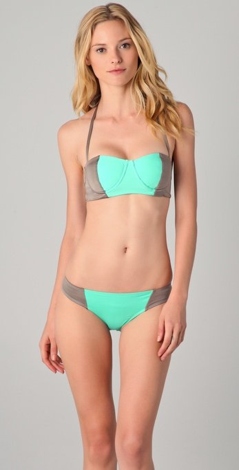 We love the way charcoal gray and seafoam green come together in this suit's silhouette. The panels are perfectly situated for you to get the most flattering cut.  One by Kore Swim Maverick Bikini Set ($206)